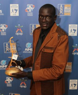 AIMS Best Marathon Runner (BMR) Award Winner Dennis Kimetto with his Award.