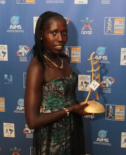 AIMS Best Marathon Runner (BMR) Award Winner Florence Kiplagat with her Award.