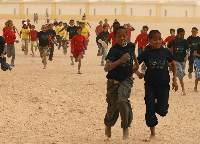 Children running in the AIMS Children's Series 2008 at the Sahara Marathon in the Smara refugee camp in the far west of Algeria