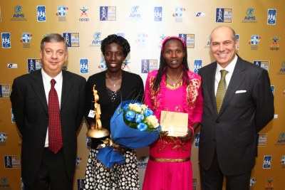 L to R:  President of SEGAS Kostas Panagopoulos, BMR women's winner Edna Kiplagat, runner-up Priscah Jeptoo and Vice-Chairman of OPAP SA, AIMS' Patron, Mr. Spyros Fokas.