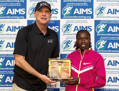 Florence Kiplagat presented with AIMS World Record Award