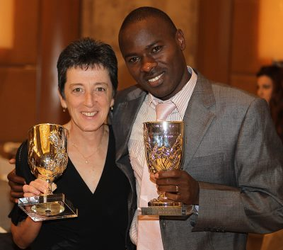 Rosa Mota  &  Patrick Makau holding their awards.