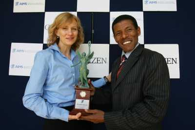 Haile Gebrselassie being presented with the AIMS/Citizen World's Fastest Time Award on 23 November 2007