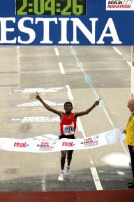Haile Gebrselassie sets a new world record in berlin.