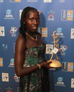 AIMS Best Marathon Runner (BMR) Award Winner Florence Kiplagat with her Award.