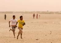 Children running in the AIMS Children's Series 2008 at the Sahara Marathon in the Smara refugee camp in the far west of Algeria