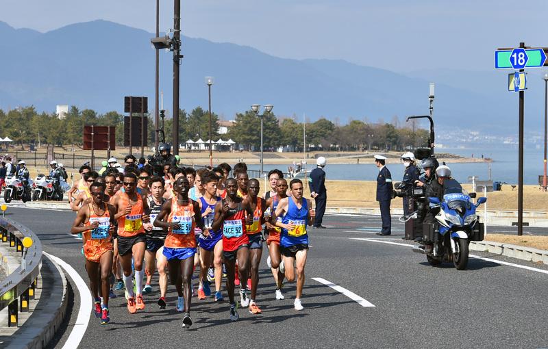 Runners running along the lake 1